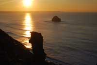 Sunset over Lanterdan Quarry at Trebarwith Strand in North Cornwall