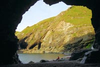 Merlin's Cave beneath Tintagel Castle, photographed from the inside looking out onto Tintagel Haven