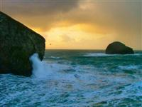 A winter storm at Trebarwith Strand with waves lashing Denis Point