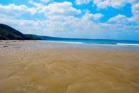 Tregardock Beach (a secluded surf beach in North Cornwall) at low tide